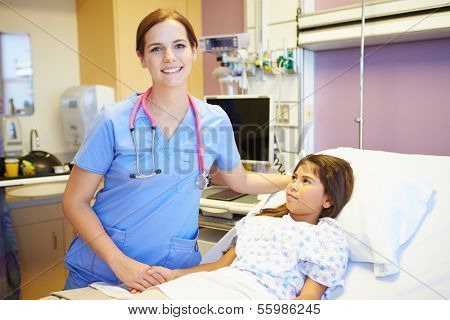 Young Girl Talking To Female Nurse In Hospital Room