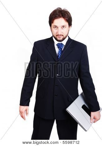 Young Male Model In Modern Suit With Laptop