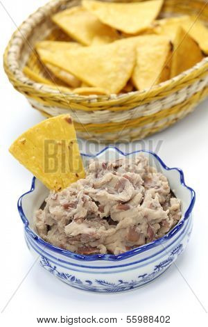 homemade frijoles with tortilla chips, totopos, mexican snack