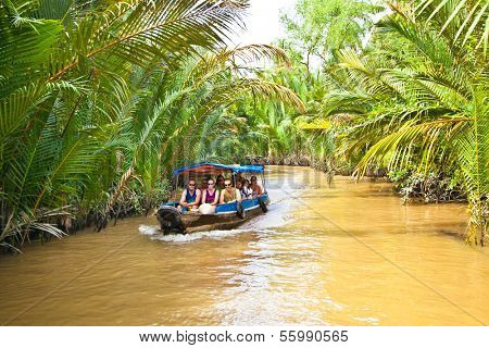 BEN TRE, VIETNAM-NOV 18, 2013: A famous tourist destination is  Ben Tre village on Nov 18, 2013. in Mekong delta , Vietnam. Mekong Delta is home of people who live along the many channels.