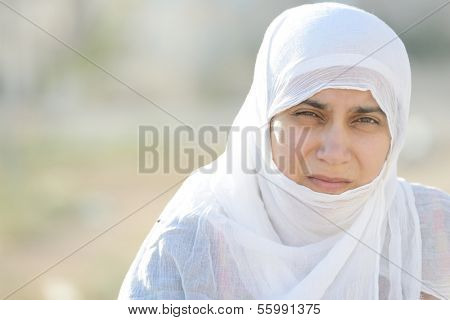 Desperate Arabic woman on Middle East