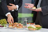 stock photo of buffet  - Business people discussing at the lunch buffet - JPG