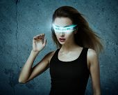 stock photo of fantastic  - Fantastic Woman Using Virtual Glasses - JPG
