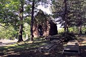 foto of brownstone  - Small brownstone chapel surrounded by shade trees in a large