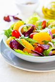 stock photo of rocket salad  - Orange with rocket and lettuce salad in a bowl - JPG