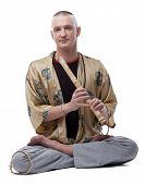 image of guru  - Yoga guru playing flute - JPG