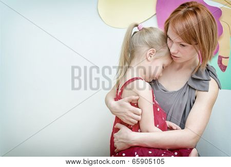 Mother Hugging Her Sad Child.