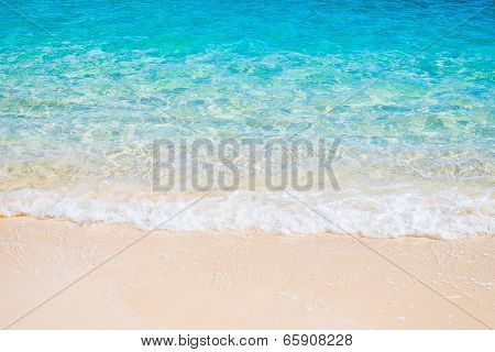 White Sand Beach And Blue Sea Wave
