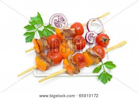 Skewers Of Meat With Vegetables On A Plate Isolated On A White Background.