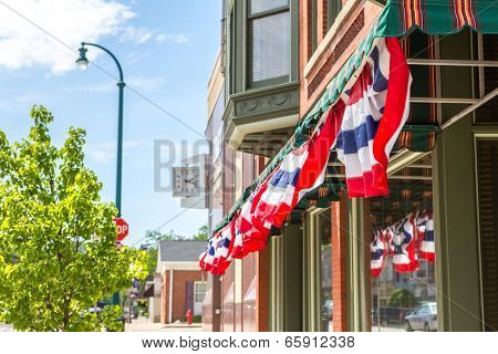 Patriotic  bunting on a business in a small town, shallow depth