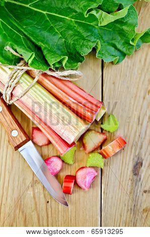 Rhubarb Cut With Leaf On A Wooden Board