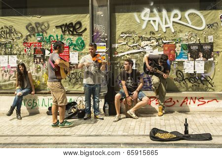 ATHENS, GREECE - MAY 10, 2014: Unidentified street musicians play for tourists. Tourism is a decisive sector of hope for Greek economy - In the year Greece receives about 18 million tourists.