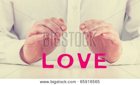 Protective Hands Over Word Love