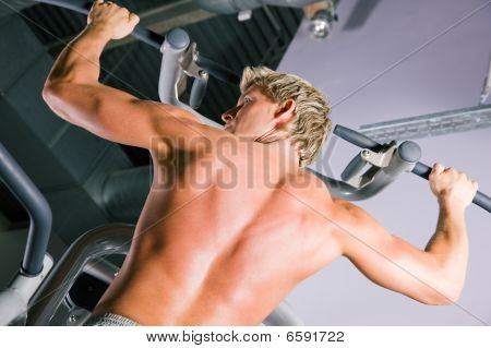 Strong man working out in gym