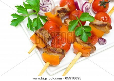 Kebab Meat With Vegetables On A White Plate - White Background.