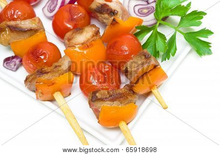 Kebab With Meat And Vegetables On A White Plate On A White Background