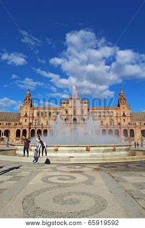Tourists At The Plaza De Espana In Seville, Spain Vertical