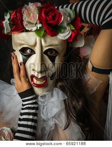 Closeup Of Woman In A Jester Like Pierrot Mask