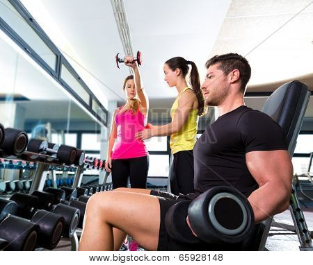 Dumbbell man at gym workout fitness weightlifting and dumbbell women personal trainer