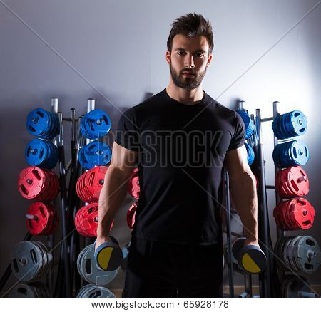 Dumbbell man workout fitness club at weightlifting gym
