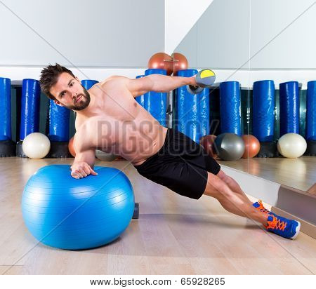Fitball abdominal side push ups Swiss ball man pushup at fitness gym
