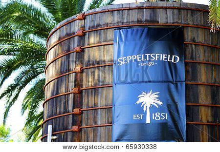 Barossa Valley, South Australia – May 29, 2014: Large Blue Signage On Old Wood Vats At Entrance Of S