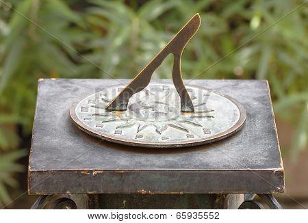 Ancient Roman Sundial In Garden