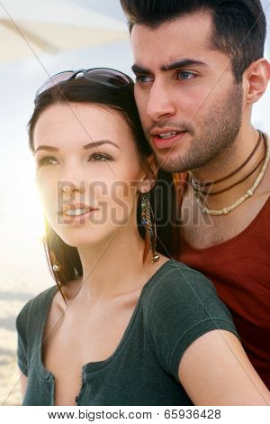 Portrait of young attractive loving couple looking to the distance.
