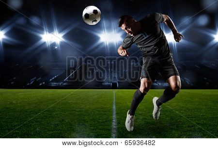 Hispanic Soccer Player heading the ball