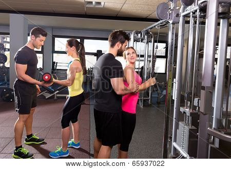 cable pulley system gym and dumbbell fitness people group with personal trainer