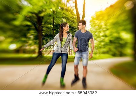 young happy roller couple in park,  time for roller blades - shoot with lensbaby