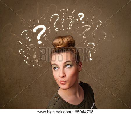 Teenage girl with question mark symbols around her head