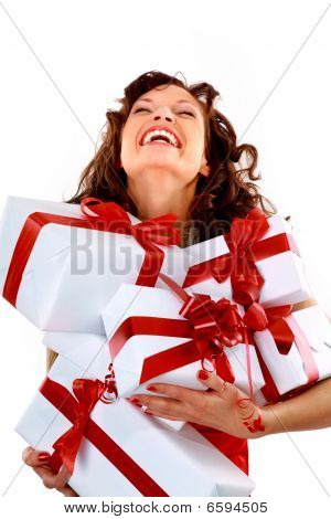 woman with many gift boxes and bags