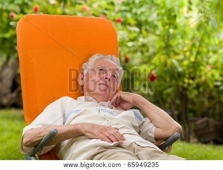 Man Enjoying In Sunbed