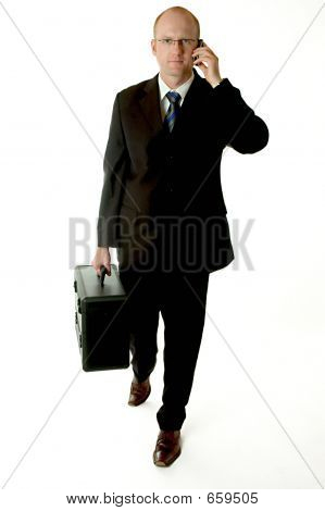 businessman walking and phoning