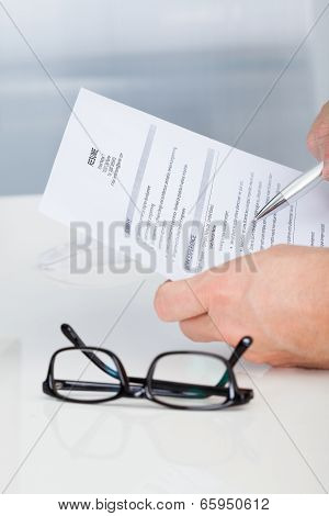 Man Holding Curriculum Vitae