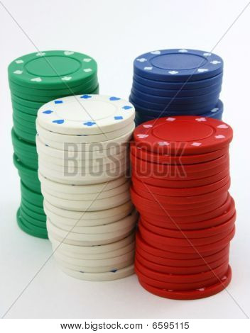 Stacks of poker chips green, red, white, blue portrait