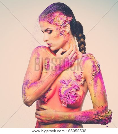 Fragility of a human creature conceptual body art on a woman