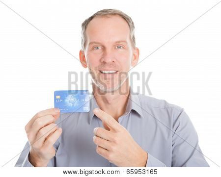Mature Businessman Showing Credit Card