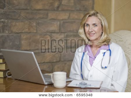 Female Doctor At Her Desk And Relaxing