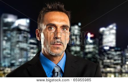 Mature businessman in the city at late night