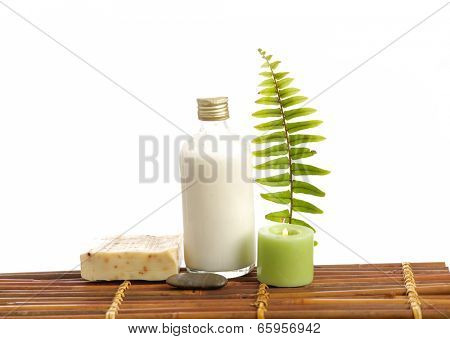 Set of massage oil and fern,candle,soap on bamboo mat