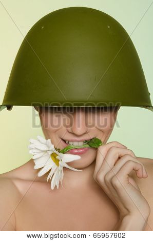 Woman In A Military Helmet Bites Chamomile