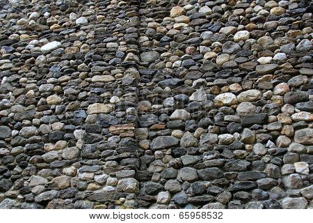 Old wall of gray and white stone
