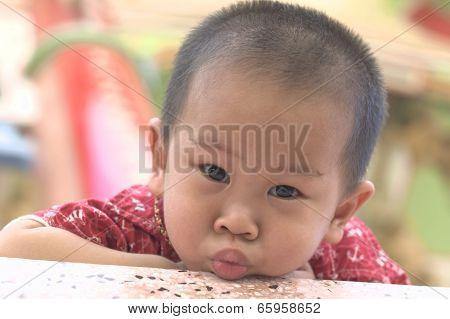 Toddler duck face