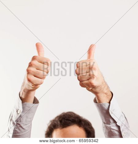 close up of young thumbs up isolated