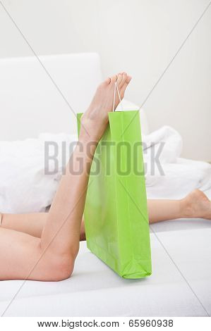 Woman Holding Shoppingbag With Leg