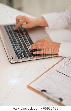 Closeup On Medical Doctor Woman Working On Laptop