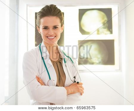 Portrait Of Smiling Medical Doctor Woman In Front Of Fluorograph