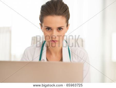 Portrait Of Medical Doctor Woman Working On Laptop